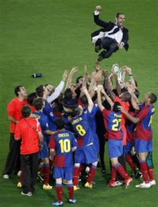 4190899564-barcelona-coach-pep-guardiola-is-thrown-in-the-air-in